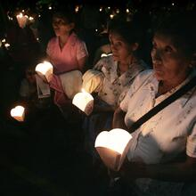 A file photo shows Salvadorans gathering during a candlelight service in San Salvador to commemorate the 1989 killing of six Jesuits and two women during El Salvador's civil war. (CNS photo/Luis Galdamez, Reuters)