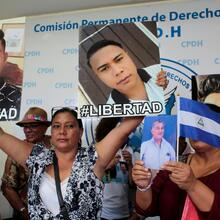 Relatives hold pictures during a 2019 news conference in Managua to demand the release of the demonstrators detained during 2018 protests against the government. (CNS photo/Oswaldo Rivas, Reuters)