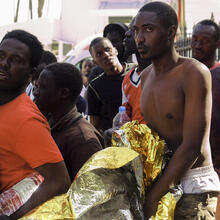 Newly arrived migrants are transferred by Spanish police to a temporary location after arriving at the coast of Gran Canaria island, Spain, on Nov. 1. Crossing the Atlantic Ocean sailing on a wooden boat, a group of 44 migrants had arrived at Maspalomas beach. (AP Photo/Javier Bauluz)