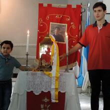 Matheus Vianna and Gabriel Terron pose before a relic of Carlo Acutis in 2015.Photo courtesy of St. Sebastian's church in Campo Grande,Mato Grosso do Sul,Brazil.
