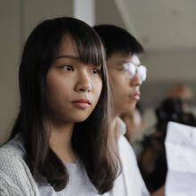 In this Friday, Aug. 30, 2019, photo, pro-democracy activists Joshua Wong, right, and Agnes Chow speak to media outside a district court in Hong Kong. Wong, Chow and activist Ivan Lam have been sentenced to jail on Wednesday, over charges related to an unauthorized anti-government protest last year at the city's police headquarters. (AP Photo/Kin Cheung)