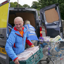 In August volunteers unload a van of food donations to a local food bank in the town of Penicuik, in Midlothian, Scotland. iStock
