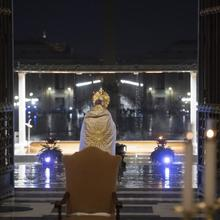 Pope Francis leads Benediction during a prayer service in an empty St. Peter's Square at the Vatican March 27, 2020. Although the pope usually draws large in-person crowds, during the COVID-19 pandemic his assemblies have reached the faithful through television, radio and the internet. (CNS photo/Vatican Media)