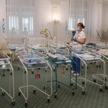 A nurse and newborns are seen in the Hotel Venice, which is owned by BioTexCom. a surrogacy agency in Kyiv, Ukraine, May 14, 2020. Dozens of babies born to surrogate mothers are stranded in Ukraine as the COVID-19 pandemic lockdown prevents their foreign parents from collecting them. The country's Catholic bishops have called for a halt to commercial surrogacy. (CNS photo/Gleb Garanich, Reuters)