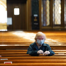 Alice Claus prays the rosary at St. Kevin Church in the Flushing section of the New York City borough of Queens on May 26, the first day the Diocese of Brooklyn, N.Y., permitted its churches to reopen amid the COVID-19 pandemic. (CNS photo/Gregory A. Shemitz)