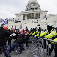 Trump supporters try to break through a police barrier on Jan. 6 at the Capitol in Washington. (AP Photo/Julio Cortez)