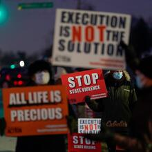 Demonstrators in in Terre Haute, Ind., gather to protest the execution of Lisa Montgomery on Jan. 12. She was put to death by lethal injection at the federal prison in Terre Haute soon after the U.S. Supreme Court lifted a hold on her execution at 1:31 a.m. (EST). She was the first woman to be put to death in federal prison since 1953. (CNS photo/Bryan Woolston, Reuters)