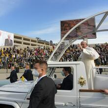 Pope Francis greets the crowd as he arrives to celebrate Mass at Franso Hariri Stadium in Erbil, Iraq, on March 7. (CNS photo/Vatican Media)