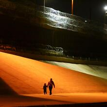 Migrants from Honduras walk toward Border Patrol agents in El Paso, Texas, to turn themselves in on March 29, 2021. (CNS photo/Edgard Garrido, Reuters)