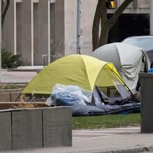 Homeless camp set up in park in middle of University Avenue in downtown Toronto by the Court House during Covid-19 pandemic on April 3, 2020.