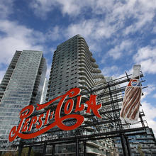 A landmarked PepsiCola sign stands in Long Island City near the site for a proposed Amazon headquarters in the Queens borough of New York, Friday, Nov. 16, 2018. The sign previously was part of a former bottling plant nearby. City and state officials promised at least $2.8 billion in tax credits and grants to lure Amazon to Queens, where it would occupy a new campus built around a formerly industrial boat basin. (AP Photo/Mark Lennihan)