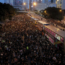 Protesters gather on a main road near the Legislative Council on June 16 as they continuing protest against the unpopular extradition bill in Hong Kong. (AP Photo/Kin Cheung)