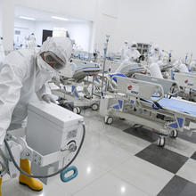Staff inspect medical equipment at an emergency hospital set up amid the coronavirus outbreak in Jakarta, Indonesia, on, March 23. (Hafidz Mubarak A/Pool Photo via AP)