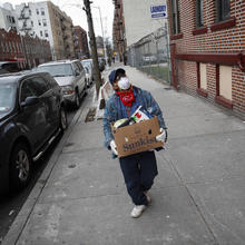 Francisco Ramírez delivers grocery donations in a neighborhood with a large immigrant population in the Bronx, New York, on April 18. (AP Photo/John Minchillo)