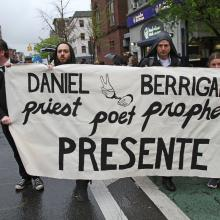 Mourners participate in a peace march on May 6 prior to the funeral Mass of Jesuit Father Daniel Berrigan in New York City (CNS photo/Gregory A. Shemitz).