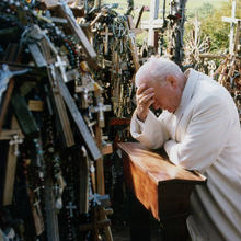 Pope John Paul II prays in 1993 at the Hill of Crosses in Siauliai, Lithuania. Pope Francis will make the same three-nation visit, stopping at a number of the same places as his saint-predecessor. (CNS photo/Arturo Mari, L'Osservatore Romano)