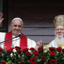 Pope Francis and Ecumenical Patriarch Bartholomew of Constantinople greet a small crowd after delivering a blessing in 2014 in Istanbul (CNS photo/Paul Haring).