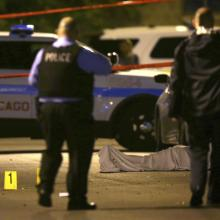 In this May 30, 2016 file photo, police work the scene where a man was fatally shot in the chest in Chicago (E. Jason Wambsgans/Chicago Tribune via AP).