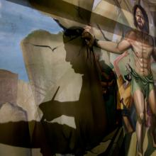 In this Monday, April 24, 2017 photo, the shadow of Coptic Christian Ayman William is reflected on a dome where he is painting a biblical scene of Samson, at Mar Girgis Church in Zawiya al-Hamra, in Cairo, Egypt.(AP Photo/Amr Nabil)