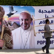 A billboard with a picture of Egyptian Coptic Pope Tawadros II, left, welcomes Pope Francis, at St. Mark's Cathedral in Cairo, Egypt, onThursday, April 27, 2017. (AP Photo/Amr Nabil)