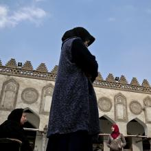 In this Feb. 20, 2017 file photo, an Indonesian al-Azhar university student, center, and an elderly Egyptian woman pray at al-Azhar Mosque, in Cairo, Egypt.(AP Photo/Nariman El-Mofty)