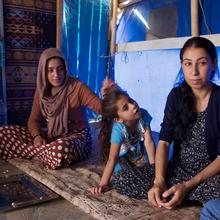 Layla Taalo, far right, with her daughter and niece. All were captives of ISIS. Photo by Kevin Clarke.