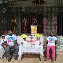 Residents of the quilombola community of Itacoã-Miri, in Pará State, celebrate the festivity of Círio de Santa Maria. The traditional procession was cancelled, so residents stood in front of their homes as a motorcycle circulated with a statue of the Blessed Mother. Photo by Elisa Monteiro.