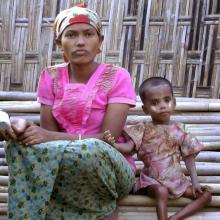 Rosmaida Bibi, right, who suffers from severe malnutrition, sits with her 20-year old mother Hamida Begum outside their makeshift shelter at the Dar Paing camp, north of Sittwe, Rakhine State, Myanmar, in March 2017. Rosmaida Bibi looks a lot like any of the underfed 1-year-olds in a squalid camp for Myanmar's displaced ethnic Rohingya minority—but she's 4. She cannot grow, and her mother can't find anyone to help her because authorities won't let Rohingya leave the camp. (AP Video)