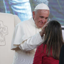 Pope Francis greets a young woman during a meeting with youths in Asuncion, Paraguay, July 12, 2015 (Paul Haring, CNS).