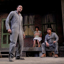 Carl Lumbly as Troy Maxson (foreground), with Margo Hall as Rose and Steven Anthony Jones as Jim Bono (background), in August Wilson's Fences (Photo: Ed Smith).