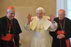 "Pope Benedict XVI is flanked by Cardinal Donald W. Wuerl of Washington, left, and Cardinal Theodore E. McCarrick, retired archbishop of Washington, during a Jan. 19 meeting with U.S. bishops on their ""ad limina"" visits to the Vatican. In a speech to the bishops, the pope issued a strong warning about threats to freedom of religion and conscience in the U.S. (CNS photo/L'Osservatore Romano) (Jan. 19, 2012)"