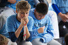 Campers pray the rosary July 24 during Mike Sweeney Catholic Baseball Camp at the Russell Road Sports Complex in Kent, Wash. (CNS photo/Stephen Brashear)