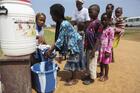Children encouraged to wash hands at Ebola sensitization program in Liberia.