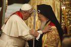 Pope Francis, Ecumenical Patriarch Bartholomew of Constantinople embrace during prayer service in Istanbul.