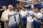 Pope Francis receives a Catholic Charities jersey and an autographed soccer ball during his meeting with immigrant families at Our Lady Queen of Angels School in the East Harlem area of New York in September 2015. (CNS photo)