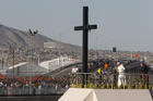 Pope Francis prays at a cross on the border with El Paso, Texas, before celebrating Mass at the fairgrounds in Ciudad Juarez, Mexico, Feb. 17. (CNS photo/Paul Haring)