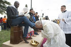 Pope Francis kisses the foot of a refugee during Holy Thursday Mass of the Lord's Supper at the Center for Asylum Seekers in Castelnuovo di Porto, about 15 miles north of Rome in March 2016. The pope washed and kissed the feet of refugees, including Muslims, Hindus and Copts. (CNS photo/L'Osservatore Romano, handout)