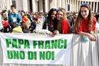 "Young pilgrims display a banner that says ""Pope Francis One of us"" as the pontiff celebrates Mass for the Youth Jubilee in St. Peter's Square at the Vatican in April 2016. (CNS photo/Ettore Ferrari, EPA)"