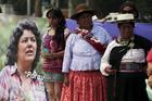 Women participate in an April 26 memorial service in San Salvador, El Salvador, for murdered environmental rights activist Berta Caceres Flores. (CNS photo/Jorge Cabrera, Reuters)