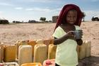 Life at a refugee camp in Kindjani, Niger, for Nigerians fleeing Boko Haram in 2016: A young girl drinks water delivered to the community by Catholic Relief Services. (CNS photo/Michael Stulman, CRS)
