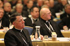 Bishop James F. Checchio of Metuchen, N.J., listens to a speaker during last year's fall general assembly of the U.S. Conference of Catholic Bishops in Baltimore. (CNS photo/Bob Roller)