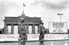 "Border policemen stand next to the sign at the Berlin Wall and Brandenburg Gate in Berlin June 17, 1986. The sign says: ""Achtung! Sie verlassen jetzt West-Berlin"" (Attention, you are leaving West Berlin). (CNS photo/Wolfgang Kumm, EPA)"