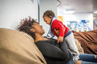 A woman plays with her 1-year-old son at Our Lady's Inn maternity home in St. Louis. African-American women suffer rates of maternity-related mortality three times higher than white women. (CNS photo/Lisa Johnston, St. Louis Review)
