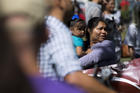 A woman holds a child during an immigration rally near the U.S. Capitol in Washington Sept. 26. (CNS photo/Tyler Orsburn)