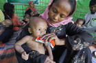 A woman from Myanmar feeds her child in a U.N. clinic for severely malnourished Rohingya children Oct. 28 in the Balukhali Refugee Camp near Cox's Bazar, Bangladesh. More than 600,000 Rohingya have fled government-sanctioned violence in Myanmar for safety in Bangladesh. (CNS photo/Paul Jeffrey)