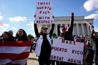Members of the Hispanic Federation participate in a Unity March in November 2017 in front of the Lincoln Memorial in Washington to highlight the ongoing humanitarian and natural disaster crisis in Puerto Rico. (CNS photo/Yuri Gripas, Reuters)