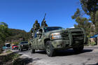 Armed members of the Mexican Army and state police arrive in Chilapa in 2016 to participate in an operation against organized crime. (CNS photo/Francisca Meza, EPA)
