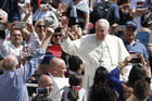 Pope Francis greets the crowd after celebrating Mass marking the feast of Divine Mercy in St. Peter's Square at the Vatican April 8. (CNS photo/Paul Haring)