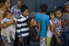Children wait in line for a meal at the Juventud 2000 migrant shelter in Tijuana, Mexico, April 25.