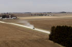 A truck travels along a dirt road near a grain farm in Hesper Township, Iowa. The 2018 farm bill was defeated on the floor of the House May 18. It could back for a second vote in late June, but Catholic and other rural life advocates see a need for improvements in the measure before then. (CNS photo/Bob Roller)
